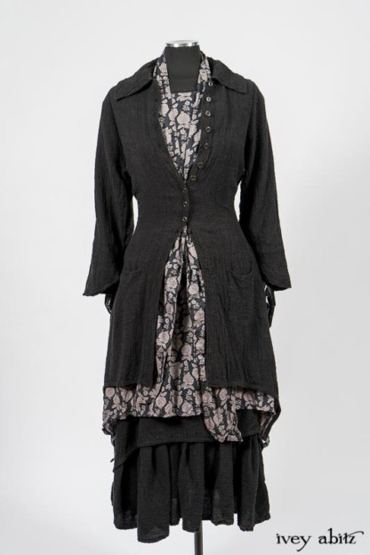 Elsie Duster Coat in Black Puckered Check Weave; Limited Edition Blanchefleur Sash in Wolfie Grey Floral Voile; Wildefield Frock in Wolfie Grey Floral Voile; Blanchefleur Frock in Black Puckered Check Weave. By Ivey Abitz