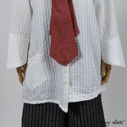 Highlands Shirt in White Clapboard Weave; Fairholme Necktie in Red Door Washed Cotton; Montague Trousers in Lakeland Woven Stripe. By Ivey Abitz