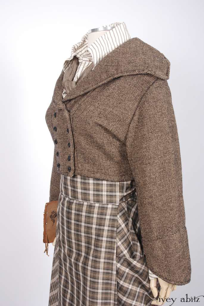 Eleanora Jacket in First Edition and Parchment Checked Chenille; Fairholme Shirt in Antique Parchment Raised Striped Weave; Fairholme Necktie in Antique Parchment Herringbone Weave; Fairholme Skirt in Parchment and Ink Plaid Weave.   Ivey Abitz Bespoke Clothing.