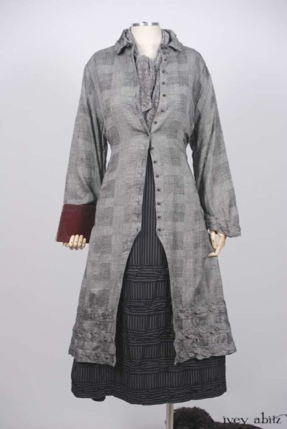 Bartholomew Duster Coat in Ink and Birch Patchwork Plaid; Clotaire Sash in Ink and Birch Floral Silk Gauze; Bertie Frock in Ink and Parchment Striped Washed Silk.   Ivey Abitz Bespoke Clothing.