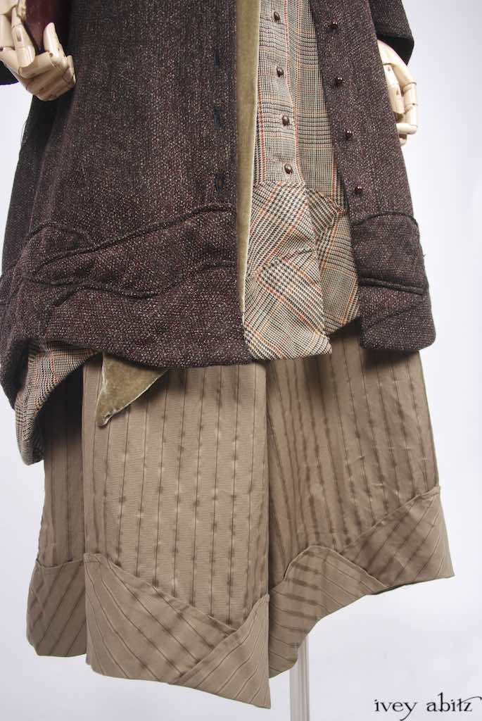 Grasmere Duster Coat in Autumnal Soft Chenille Weave; Grasmere Vest in Soft Glen Plaid Wool; Fairholme Sash in Treetop Silk Velvet; Fairholme Necktie in Harvest Embroidered Weave; Grasmere Trousers in Treetop Raised Striped Weave.   Ivey Abitz Bespoke Clothing.