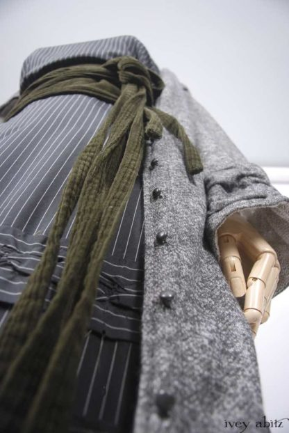 Mewland Jacket in Ink and Birch French Knit; Porte Cochere Sash in Whisper Green Corduroy; Bertie Frock in Ink and Parchment Striped Washed Silk.   Ivey Abitz Bespoke Clothing.