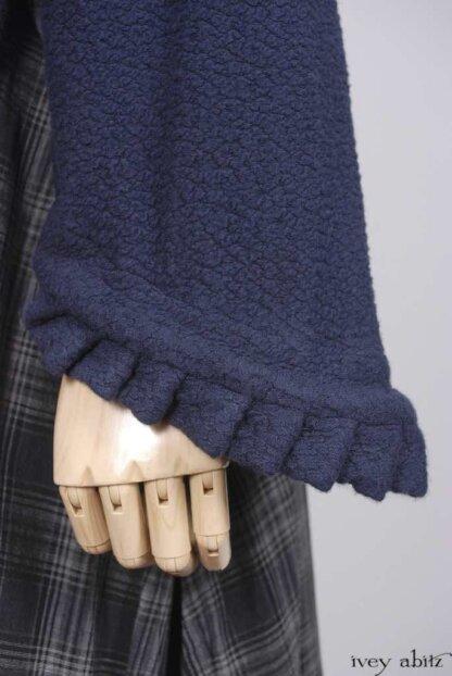 Montmorency Wrap Jacket in Horizon Blue Puckered Knit; Nook Frock in Horizon Blue Plaid Weave; Pierrepont Breeches-Leggings.   Ivey Abitz Bespoke Clothing.
