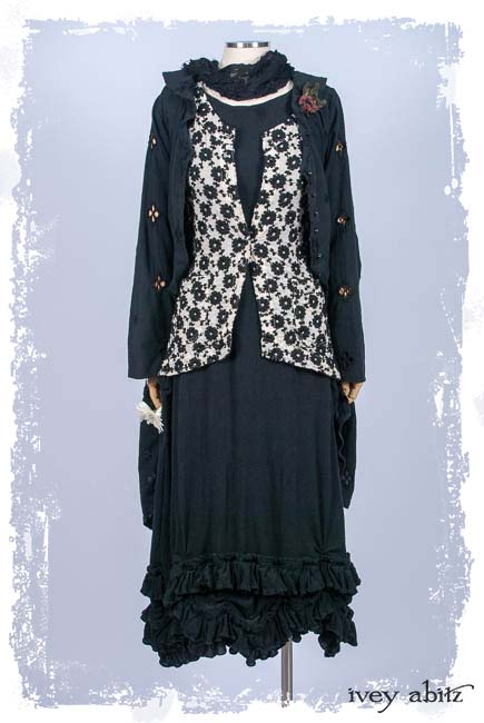Look 7: Truitt Duster Coat in Black Embroidered Eyelet; Truitt Vest in Black and Gardenia Crewel Work on Voile; Clotaire Sash in Black Floral Netted lace; Limited Edition Floravinea Brooch; Fennefleur Frock in Black Crinkled Gauze; Cilla Slip Frock in Black Silk Knit. Spring Summer 2019