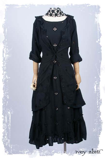 Look 14: Truitt Duster Coat in Black Embroidered Eyelet; Clotaire Sash in Black and Gardenia Crewel Work on Voile; Tilbrook Frock in Black Embroidered Eyelet; Cilla Slip Frock in Rose Silk Knit.