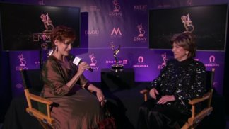 Carolyn Hennesy hosts 45th Daytime Emmys Post Show in her Ivey Abitz gown.