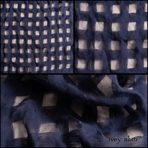 Description: Open weaves are delightful, are they not? They give you an opportunity to have depth in an ensemble without weight. You can tone down the open check design by wearing deep navy under it, or you can play it up by wearing a lighter colour under it. Have fun discovering what pleases and delights you. Your IA garments in this wonderful open check weave will give you charm and versatility in spades!Content: 90 percent linen with a hint of nylon to create the open check design. Woven in Europe. All season weave.Care: Simply hand wash or put through machine delicate cycle in cold water with a plant based detergent. We suggest using a natural fabric softener to maintain the softness we have washed into it. Tumble dry on extra-low heat with our artisan wool dryer balls to keep the relaxed effect that is featured in the Look Book.