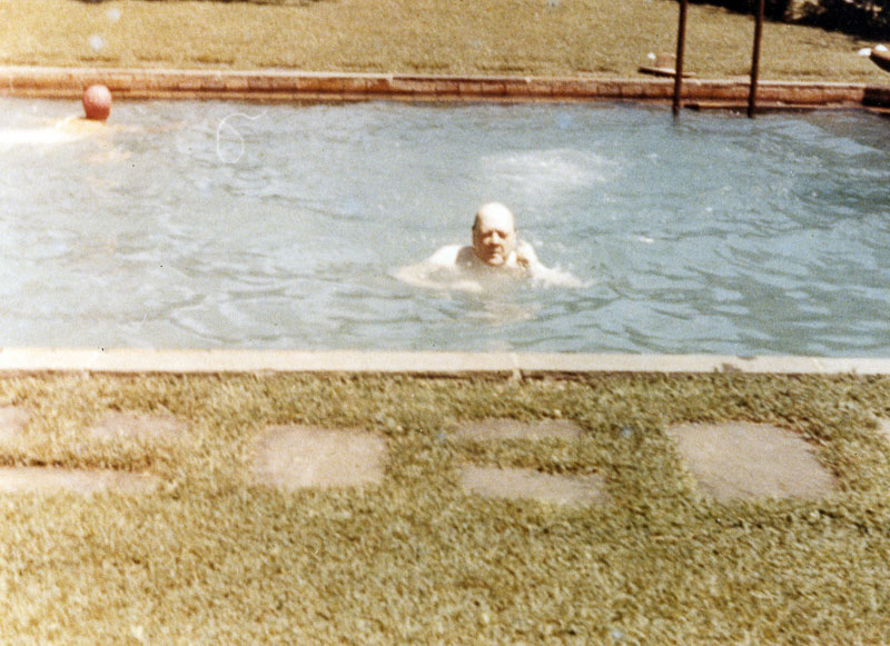 Winston Churchill, sans tophat, taking a swim in the pool beside Stone Cottage during one of his visits to Hyde Park, New York. Photograph courtesy National Park Service.